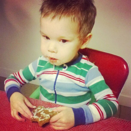 Ian eats his gingerbread man.