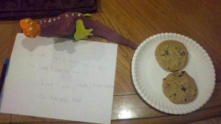 "Ginger's caption: ""Caid's letter with cookies, milk and a dragon: To Santa Santa, I want you to see this dragon I hope you like it. And I have cookies Love Caid No Bad guys aloud!"""
